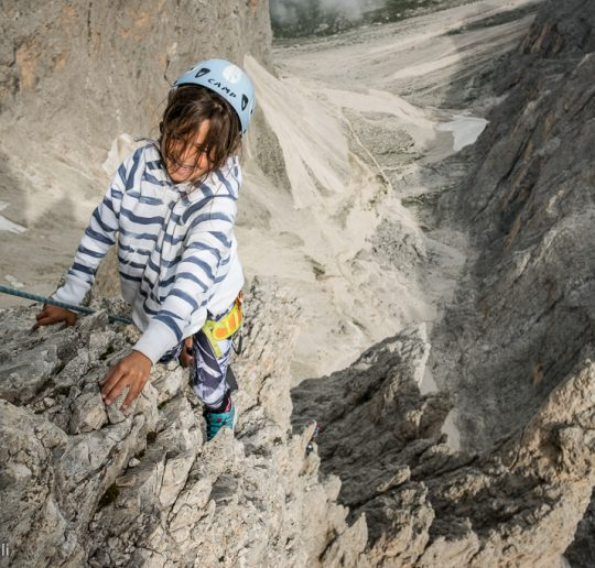 Climbing with Claudia, 8 years old, the beautiful arete of the Thumb, Cinque Dita, Sassolungo.
